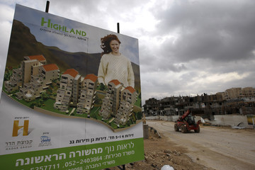 Sign advertising apartments for sale is displayed at construction site in Maale Adumim