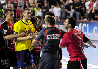 Players and referees try to separate Barcelona's Hansen from Makalovski of Vardar as they fight during their Champions League first leg handball match in Skopje