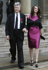 U.S. director Lynch and actress tofle leave the Elysee Palace in Paris