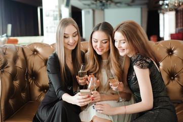 Beautiful hot girls having party fun, drinking champagne.