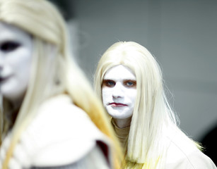 Visitors wear costumes and face make-up during the 40th annual Comic Con Convention in San Diego