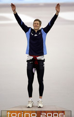 Cheek of the US celebrates after the men's speed skating 500 metres race at the Winter Olympic Games in Turin