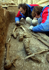 ARCHEOLOGISTS WORK ON A SKELETON IN PALEO-CHRISTIAN FUNERAL BASILICA DATING FROM THE FIFTH CENTURY ...