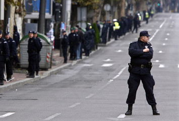 A Serbian policeman guards a street during the visit of Russias President Medvedev in Belgrade