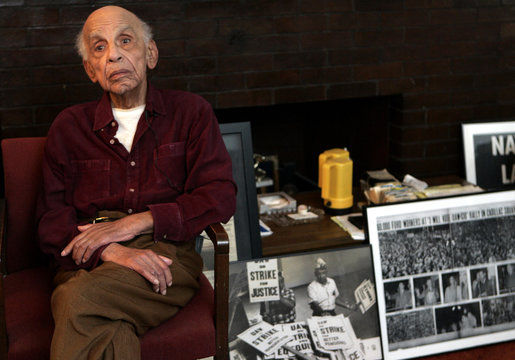 Dave Moore, UAW Local 600 activist and participant in the March 7, 1932 Hunger March on Ford Motor Co,  sits in his home in Detroit