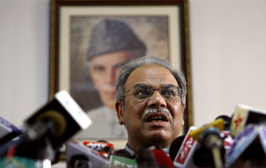 Pakistan's Foreign Secretary Khan addresses a news conference in New Delhi
