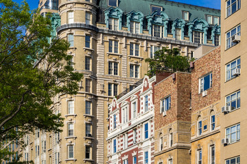 Facades of high-rise buildings on Central Park West. Upper West Side on sunny morning. Manhattan, New York City