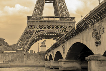Poster Eiffeltoren While French elections are making headlines, Eiffel Tower remains popular as ever with tourists, Paris France. Sepia filter