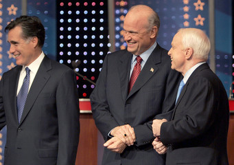 Republican presidential candidates Romney, Thompson and McCain gather with other candidates for debate in Orlando