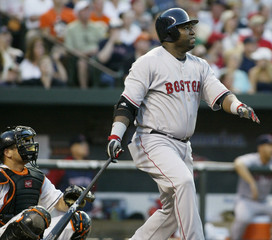 Red Sox batter Ortiz follows through on his solo home run in the third inning of their MLB American League baseball game in Baltimore