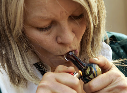 Cancer survivor Mellody Gannon smokes medicinal marijuana during a kickoff campaign in support of the Regulate, Control and Tax Cannabis Act of 2010