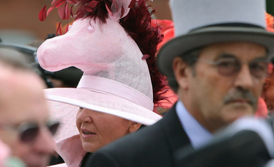 A race-goer with a hat designed as a horse arrives for Ladies Day on the third day of the Royal Ascot horse racing meet
