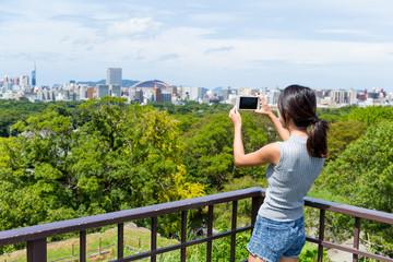 Tourist taking photo in Fukuoka city