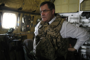 German Defence Minister Jung wears a flak jacket inside a German Armed Forces Bundeswehr aircraft in Kabul