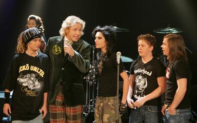 German TV host Gottschalk talks to German pop band 'Tokio Hotel' during television show in Halle