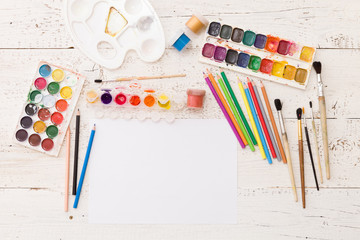 Top view on colorful paints and brushes. Creative ideas, creativity and early learning. Education concept.