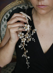 A model displays a diamond corsage ornament during a preview at Sotheby's auction house in Geneva