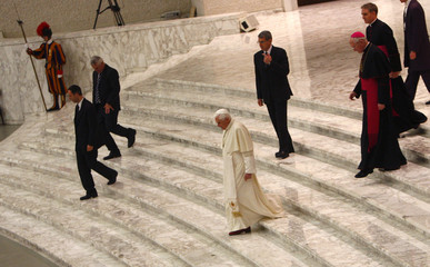 Pope Benedict XVI leaves at the end of his weekly general audience in Paul VI hall at the Vatican