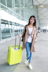 Asian young woman go travel with her luggage