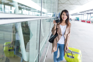 Young woman go travel and holding camera