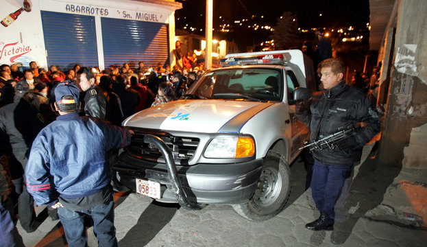 Locals try to stop a police van from taking suspected burglars away in a village in the Naucalpan district