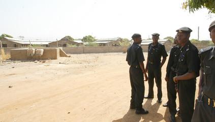 Police stand guard over empty chicken sheds at Sambawa farm in Kaduna