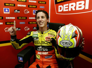 Derbi 125cc rider Pol Espargaro of Spain celebrates pole position after qualifying session at Catalunya Grand Prix at 'Circuit de Catalunya' racetrack in Montmelo, near Barcelona