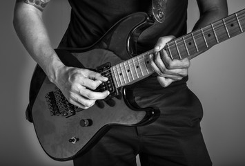 Young man playing a guitar.