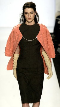 A model for Jeffrey Chow wears an iridescent khaki cotton liner jacket with quilted silk sleeves and..