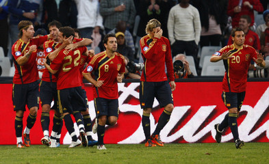 Spain's Villa celebrates after scoring against Iraq during their Confederations Cup soccer match at the Free State Stadium in Bloemfontein