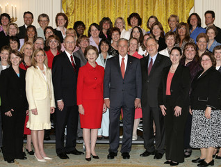 President Bush and first lady Laura Bush participate in a photo opportunity with recipients of the 2006 Presidential Awards for Excellence in Mathematics and Science Teaching