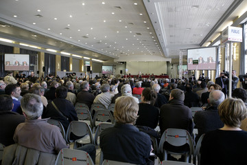 People attend the first hearing of the AZF disaster trial in the Jean Mermoz assembly room in Toulouse