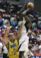 Joel Anthony of Canada goes for the basket over Alex Garcia of Brazil during the second half of men's FIBA Americas Championship semi-final basketball game in San Juan