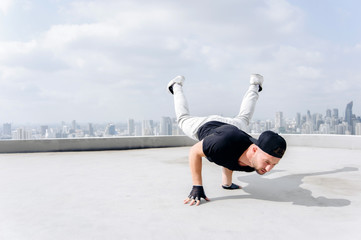 Bboy doing some stunts. Street artist breakdancing outdoors