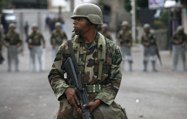 A soldier stands guard outside the Brazilian embassy in Tegucigalpa