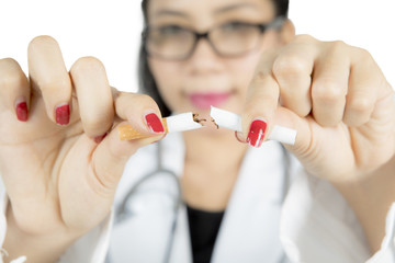 Doctor hand breaking cigarette