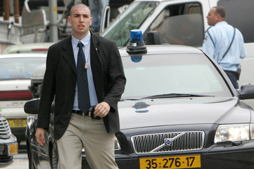 The convoy of Israeli Prime Minister Sharon leaves the hospital in Jerusalem
