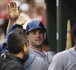 New York Mets' Wright is congratulated in dugout after scoring on broken bat single by Easley in St Louis