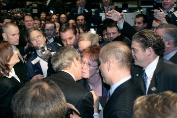President Bush receives a kiss during a visit to the New York Stock Exchange