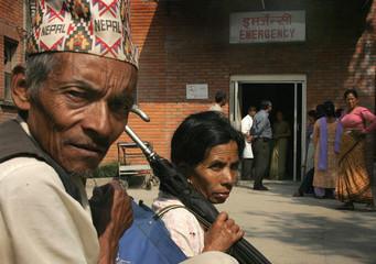 Nepali patients wait outside B and B hospital in Kathmandu