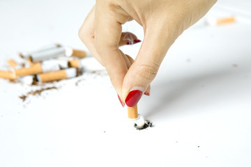 Female hand breaking cigarette