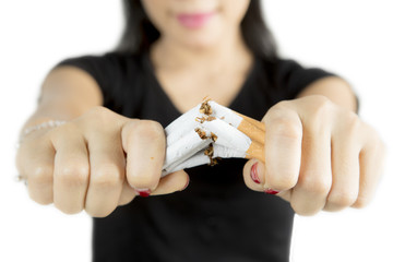Female hand destroying cigarettes