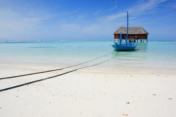 blue boat on tropical beach