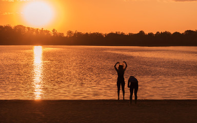 People are having fun under sunset