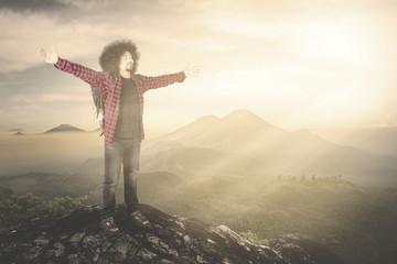 Male hiker enjoying freedom on mountain