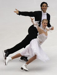 Kaitlyn Weaver (front) and Andrew Poje of Canada perform during the ISU Grand Prix of Figure Skating Cup of China in Beijing