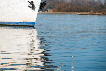 Reflection in the water of a sailboat