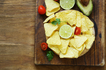 Corn chips nachos on a wooden plate