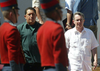 Venezuelan President Chavez receives military honors as Colombian President Uribe stands near him in Santa Marta