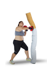 Obese female boxer punching a cigarette